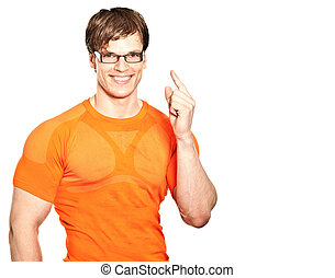 athletic young man pointing at something - athletic young...
