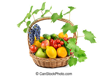 fruits and vegetables in a wicker basket isolated on white...