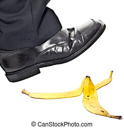 Closeup portrait of a business man foot stepping on banana...