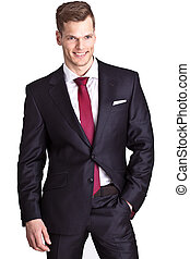 Portrait of a handsome young business man standing with hand in
