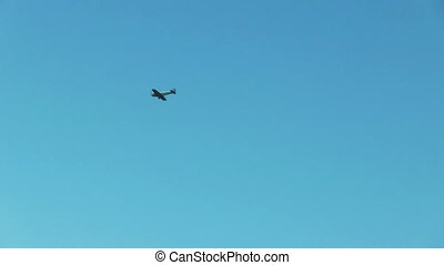 Sport aircraft flying in cloudy sky