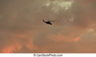 Helicopter flying in cloudy sky