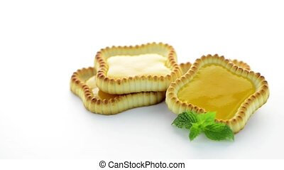 Lime jam tartlets isolated on white background.