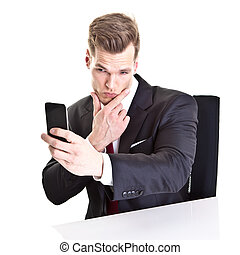 Young businessman taking a selfie with his smartphone -...