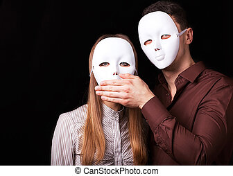 Fashion Happy Couple in Love holding with mask face....