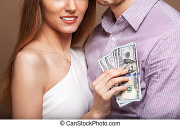 Fashion beautiful couple in love holding money the family...