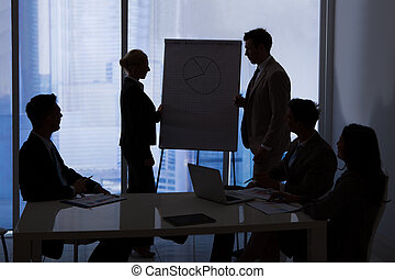 Business People Having Discussion In Conference Room -...
