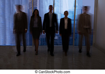 Business People Walking In Office Corridor - Blurred motion...