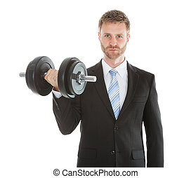 Confident Businessman Lifting Dumbbell - Portrait of...