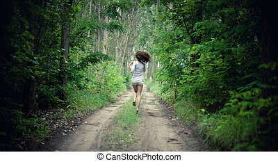 Girl in forest - The young girl runs in forest on the road