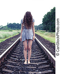 Girl on the railway - The beautiful girl stand on the...