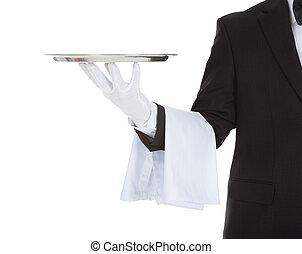 Cropped Image Of Waiter Holding Empty Tray - Cropped image...
