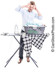Young man completely overwhelmed with his laundry and the...