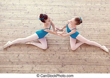 Top view of petite ballerinas dancing in studio - Top view...