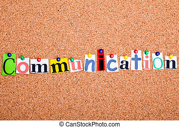 The word Communication in cut out magazine letters pinned to...