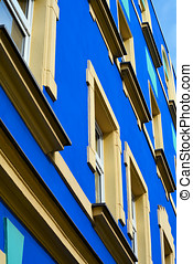 Colorful facade of a residential building in a street in...