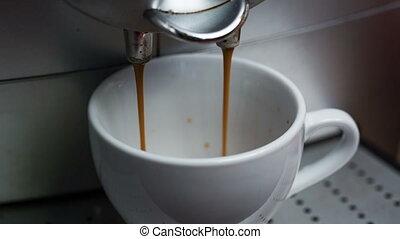 Coffee Machine Making Espresso into a Cap, closeup