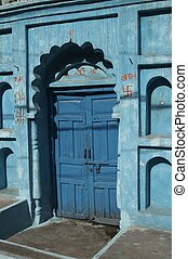 Blue Door In Blue House - Traditional Hindu house painted in...