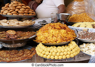 Gluttony - Piles of Indian sweets on display at a shop in...