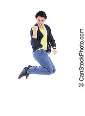 Excited successful man jumping of joy with proud expression...