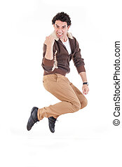 Excited man jumping out of joy achieving success - Excited...
