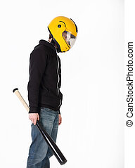 Thin man in yellow helmet and black jacket with bat in his hand