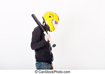 Young man in yellow helmet and black jacket with bat