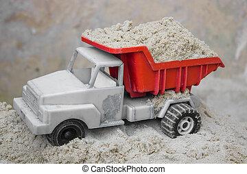 Children with sand machine