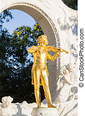 Golden Johann Strauss Statue - A golden statue of Vienna's...