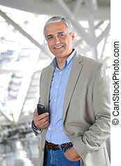 Casual Businessman with Cell Phone - A Casual Businessman...