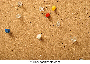 Pinboard - Various pins stuck into a corkboard for office...