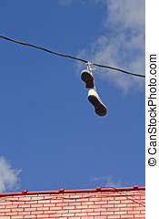 Shoes Prank - Unreachable shoes hanging over a wire by its...