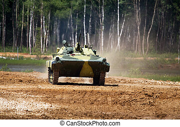 Infantry combat vehicle on a march over rough terrain