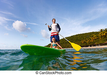 Father and daughter paddling - Father and his adorable...