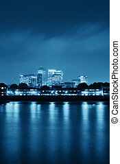 Canary Wharf in London over Thames River.
