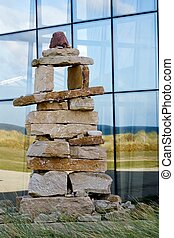 Inukshuk - Native Canadian inukshuk at Juno Beach Centre in...