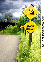 Bikeway Narrows Sign - Bikeway narrows sign on bike path in...