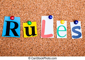 The word Rules in cut out magazine letters pinned to a cork...