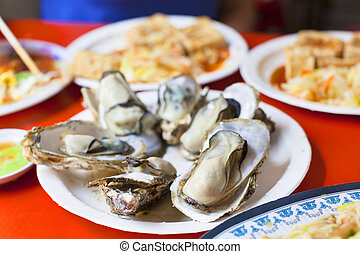 delicious and nutrition sea food ,barbecue Oysters with...