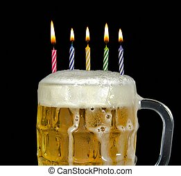 birthday candles in beer - Birthday candles in a mug of beer...