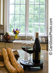 kitchen island with wine baguettes - wine and baguettes on...