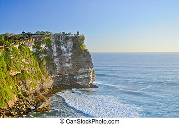 Sunset from the Pura Uluwatu temple on Bali island in...