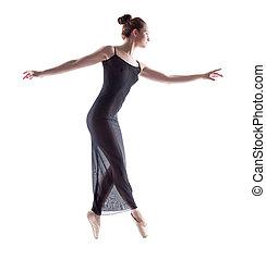 Side view of graceful ballerina dancing