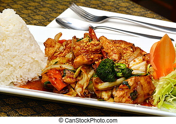 Thai chicken cashew served with jasmine rice on a plate