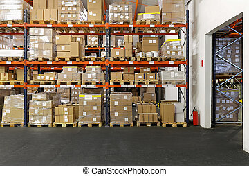 Distribution center - Boxes and crates at shelves in...