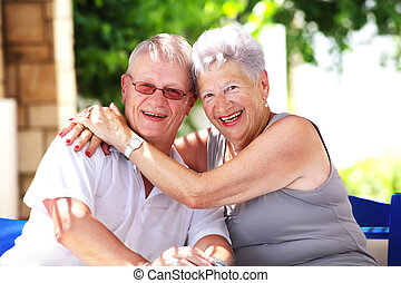 beautiful senior mother and son smiling - close-up portrait...