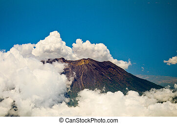 Aerial view of volcano Gunung Agung in Bali Low clouds...