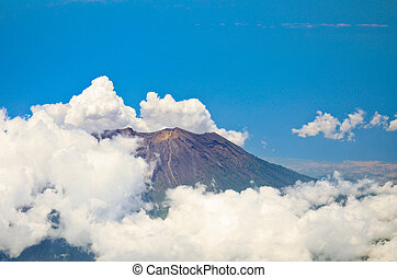 Aerial view of volcano Gunung Agung in Bali. Low clouds...