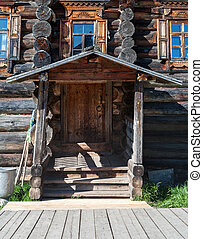 wooden porch in front of the house - Traditional wooden...