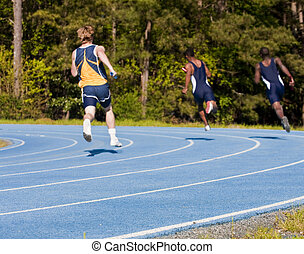 Mens Relay Race - Runners in a relay race on a new blue...